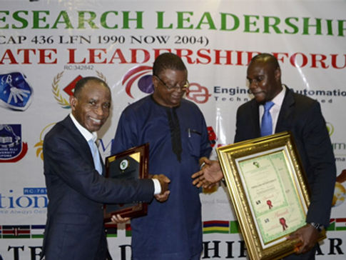 Aloy Duru, Director, & Kenneth Ediru, Business Development Manager, receive award at ceremony in Abuja