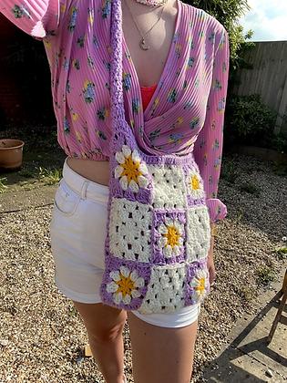 Crocheted granny squares across body bag