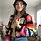 Thumbnail: Black crocheted granny squares and stripes cardigan