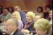 Chris on Stage Audience Laughing.JPG