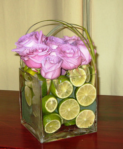 Purple roses and limes arrangment