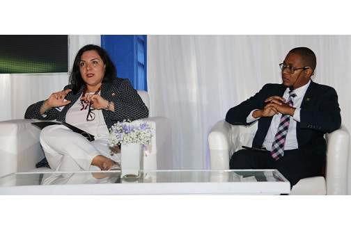 State Minister Floyd Green listens intently as Adriana La Valley, Chief of Operations at the IDB shares her perspective on support for startups in Jamaica