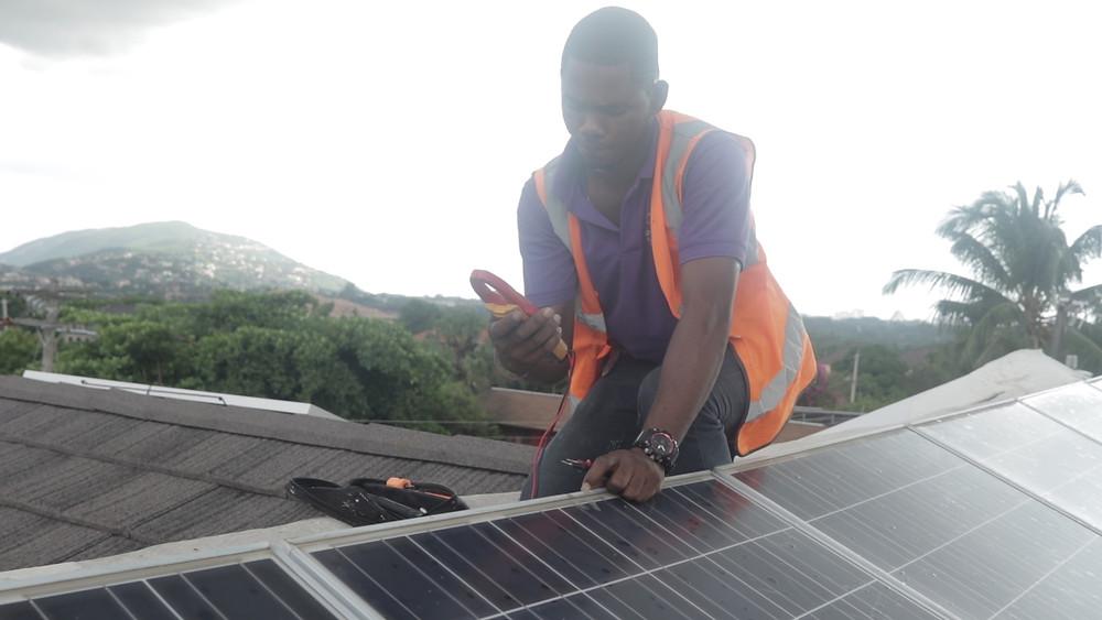 Konnexx Solar manager inspecting a solar installation.