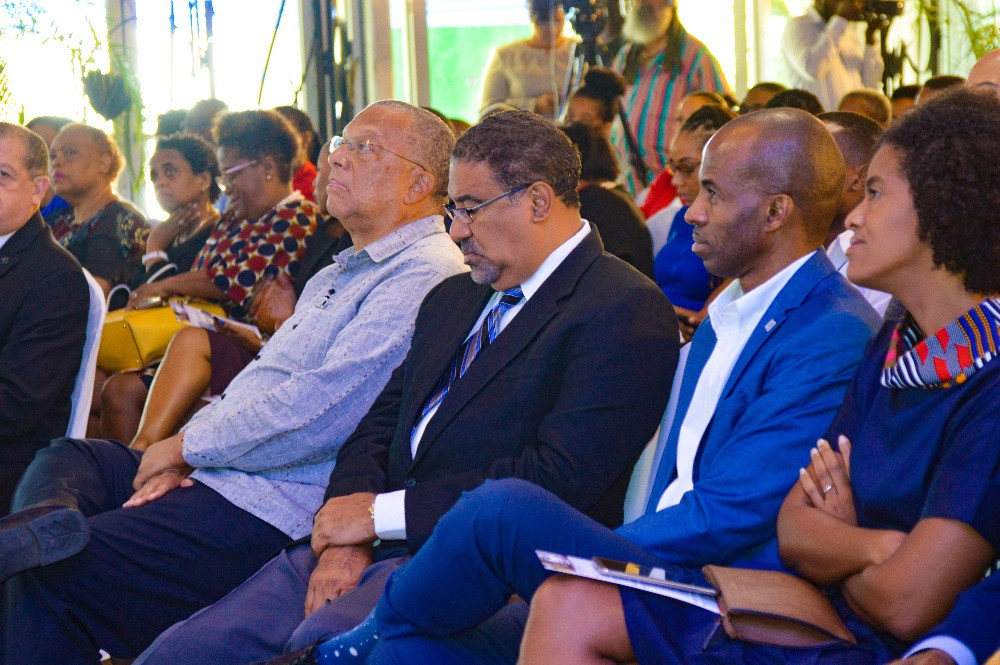 Dr. Peter Phillips, Leader of the Opposition sits alongside other members of the partner associations and MSME's as the welcome is given.