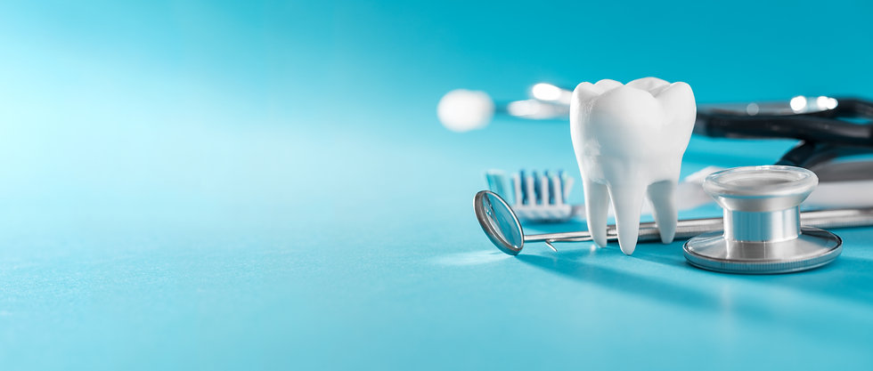 White healthy tooth, different tools for
