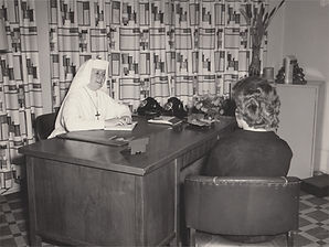 Sr. Dufault in habit with client.jpg
