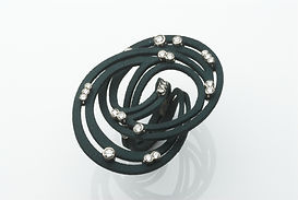 award winnign jewellery Annabel Eley cuff black nylon with diamonds set in white gold