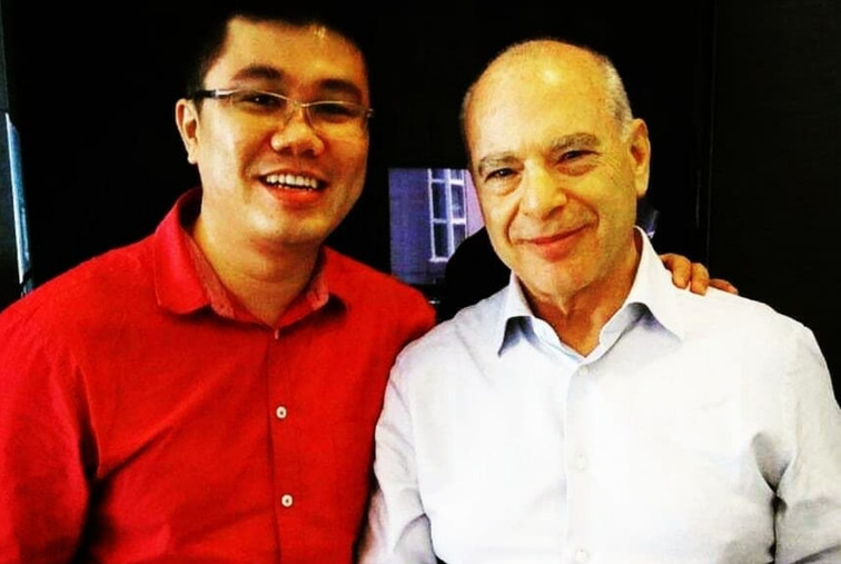 Dr Cheok with Dr Philip Levy