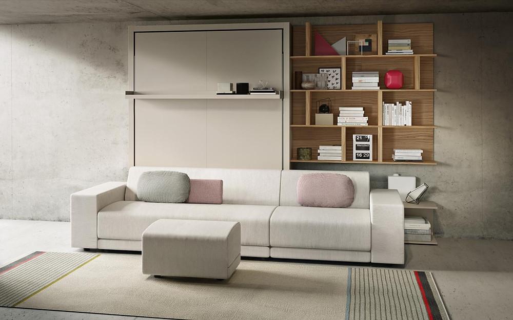 מיטת קיר הנפתחת למיטה זוגית ומשלבת מערכת ישיבה גדולה