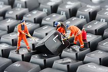 Small figurines of workers repairing com