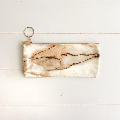 Estuche con diseño de marmol crema