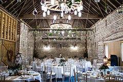 Flint Barn interior dressed forwedding reception at Peelings Manor Barns