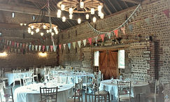 Flint Barn interir dressed for wedding reception at Peelings Manor Barns