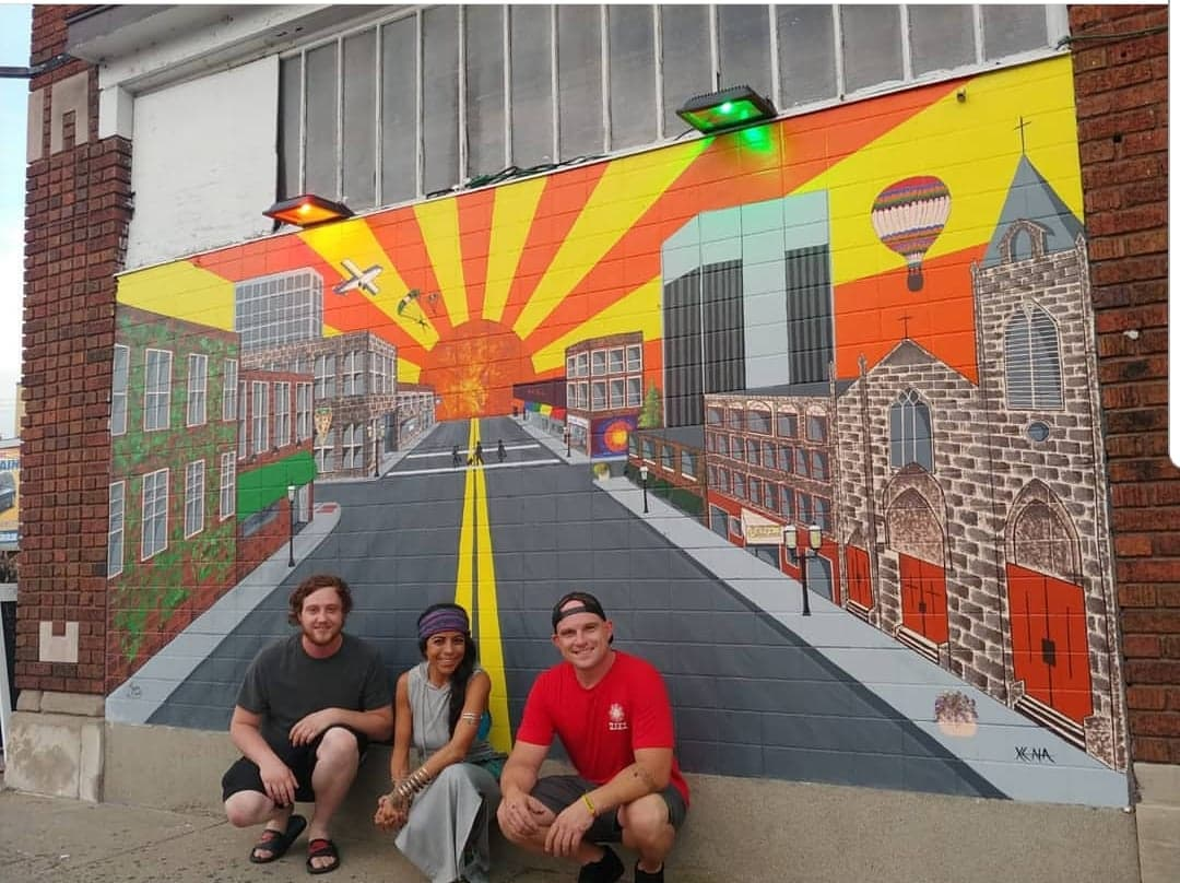The Slice Mural With Owner