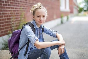 A Nice Pre-teen boy outside at school ha