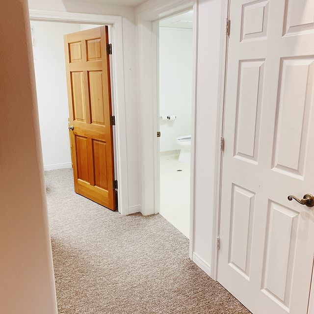 Hallway to bathroom and PCIT play room