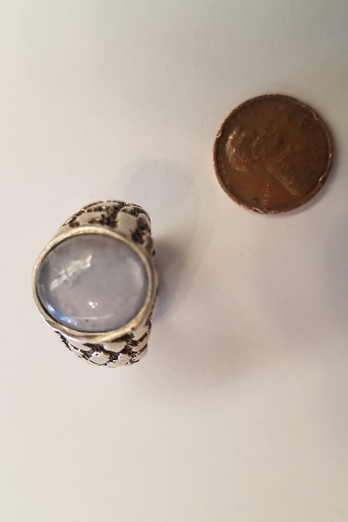 A large sterling gents ring with a nugget texture all around. It also contains a