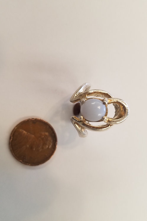 A sterling silver elegant Ellensburg blue ladies ring with a petite oval-shaped