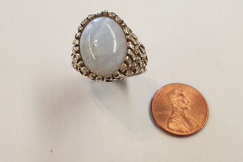 A great large sterling silver ring.It has a bold Ellensburg Blue agate oval cut