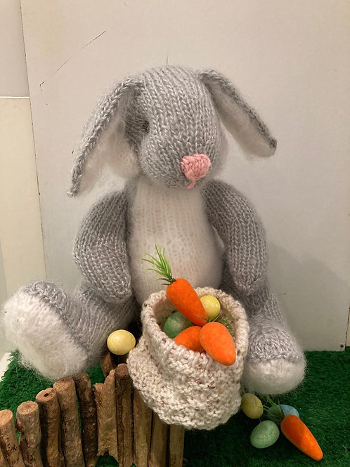 Knitted rabbit with Easter basket