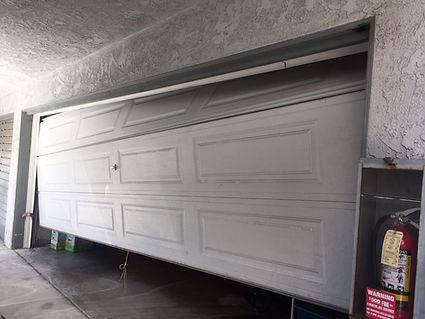 garage door off the track repair | Irvine garage door off track repair service | Same day service | Irvine roll up garage door repair | Cables, tracks, rollers & sensors same day repair | 24/7 Emergency garage door repair service in Irvine Ca