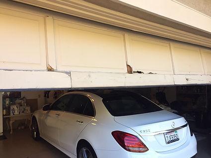 broken garage door off the track repair