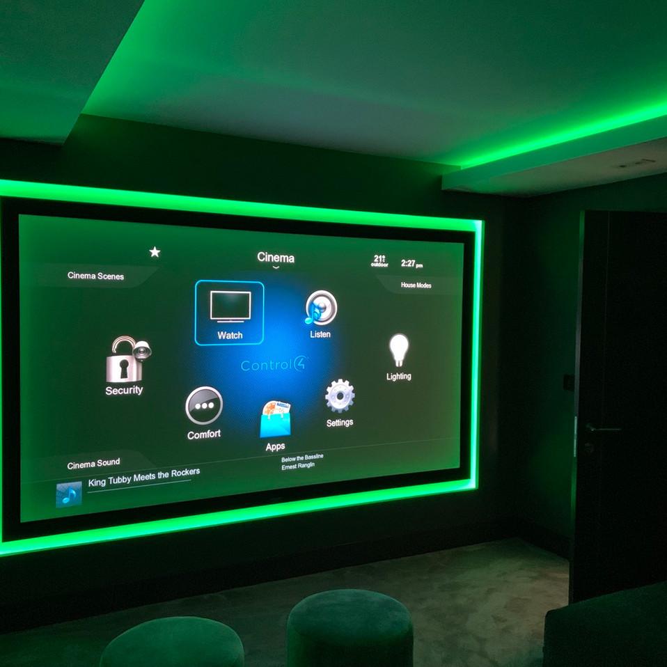 bespoke home cinema room with green led