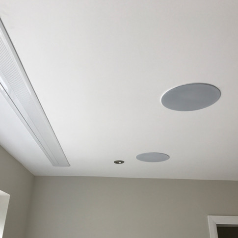 In-ceiling home cinema system