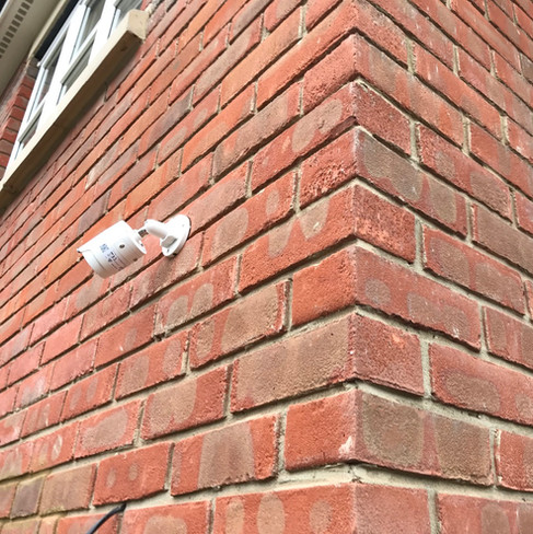 two hikvision cameras on wall.jpeg