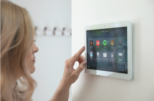 woman touching on a home automation touch screen