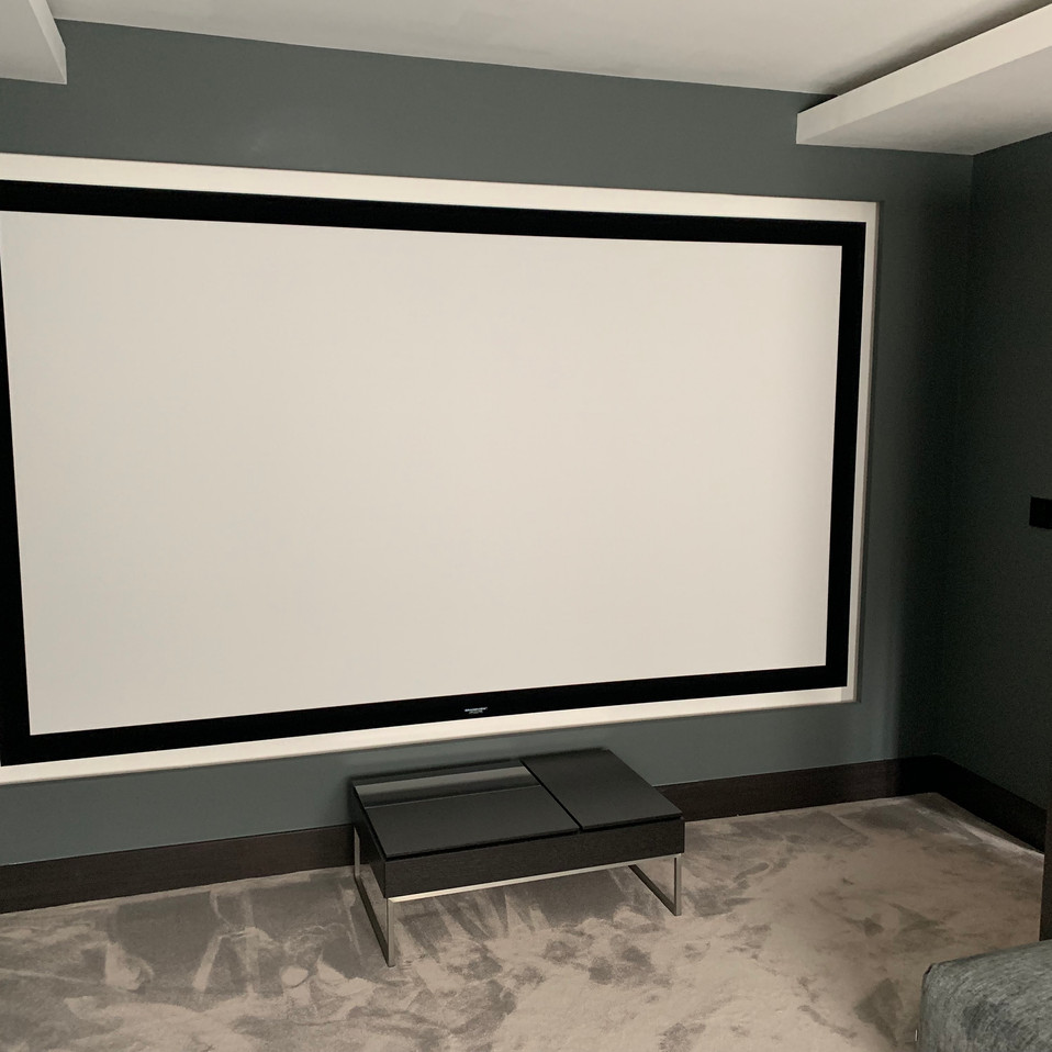 Bespoke home cinema with speakers behind