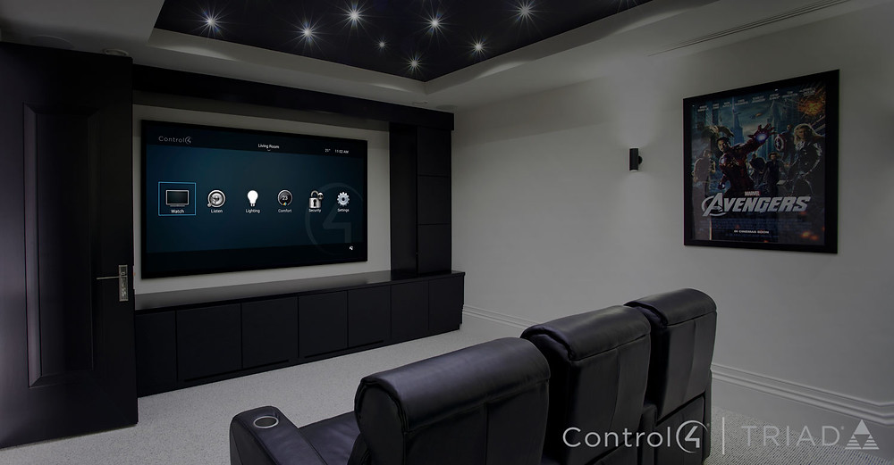 bespoke home cinema room with big tv and special seats