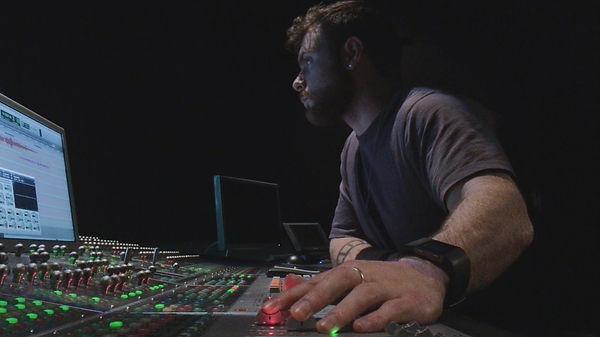 Sound designer, Derek Sepe, mixing a film