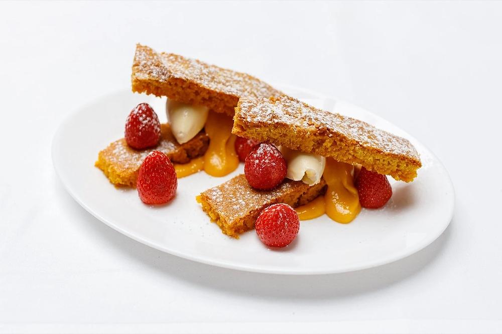 10 Greek Street's Sablé Breton, strawberries, passionfruit curd, clotted cream