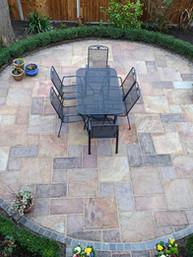 circular paved outdoor dining area