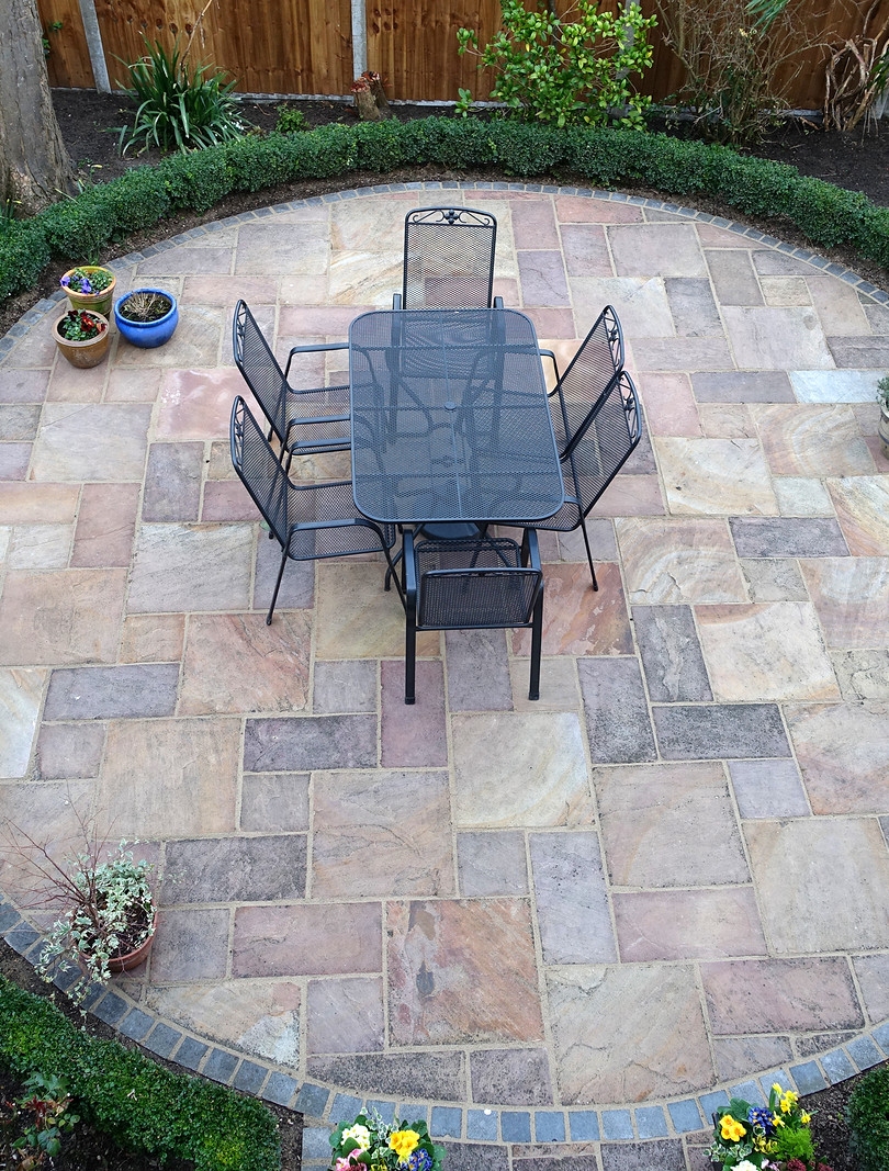 circular paved outdoor dining area
