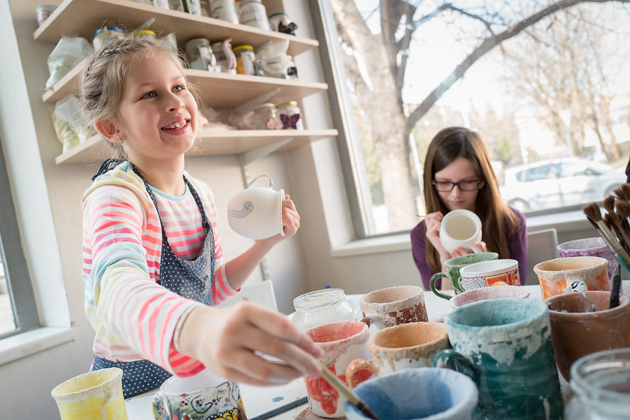 Girls and their hobby pottery painting.j