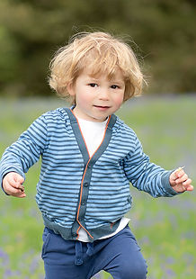Toddler in bluebell field by Rachel Fairfield Photography