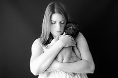 Mother holds new baby by Rachel Fairfield Photography