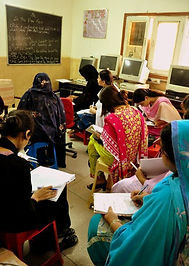 Girls in Pakistani school studying in a computer lab