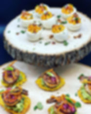 Sweet deviled eggs topped with bacon bit