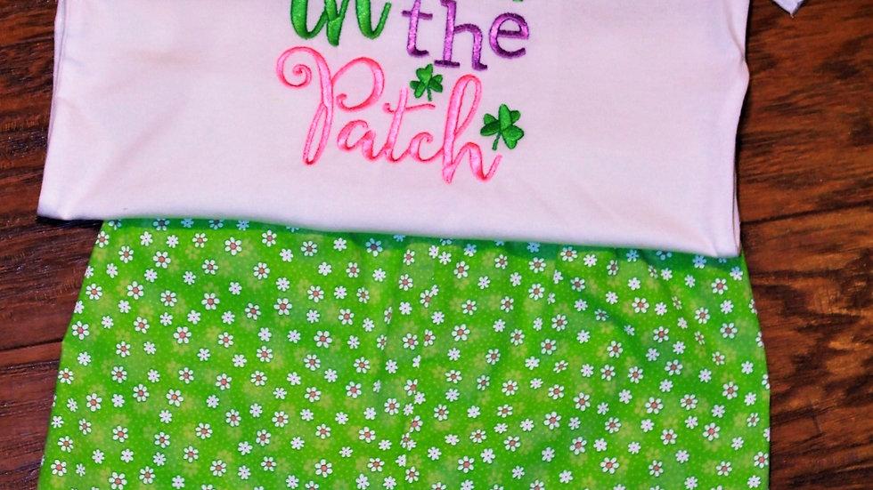 Girl St. Patrick's Day shirt and green floral ruffle shorts
