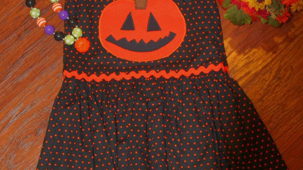 Girl Halloween pumpkin orange and black polka dot dress