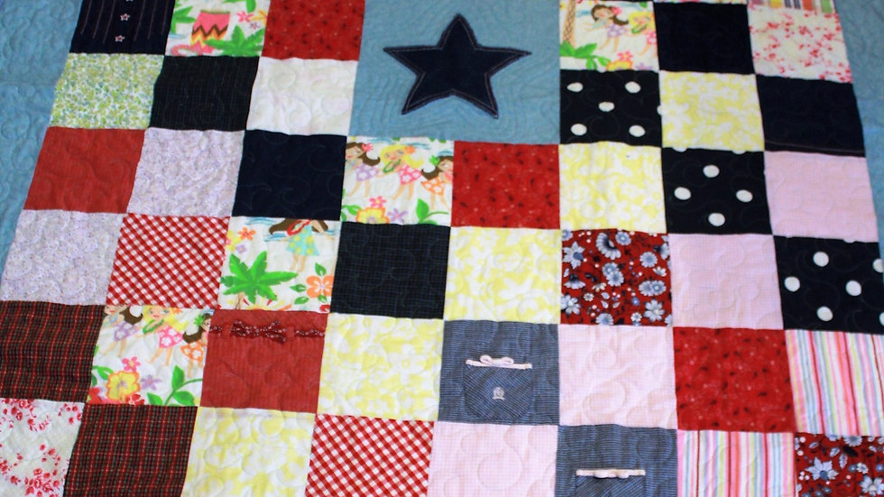 Handmade memory quilt made from little girl dresses and shirts