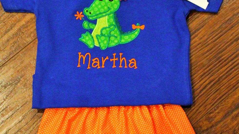 Girl alligator orange and blue football shirt orange shorts