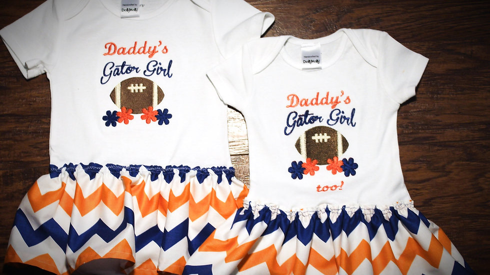 Matching sister dresses orange and blue football bodysuit
