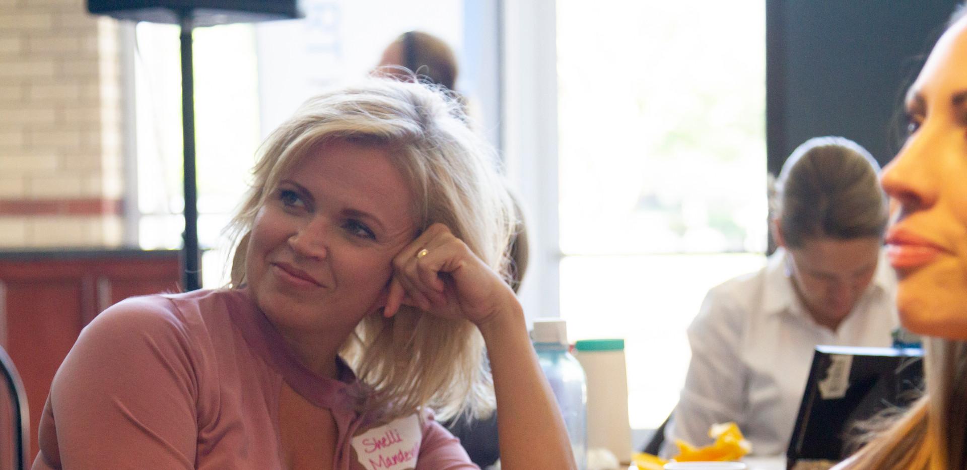 2432 Shelli listening smiling.jpg