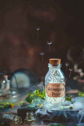 glass-potion-bottle-with-dandelion-seeds