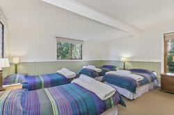 Bedroom @ King Parrot Cottages