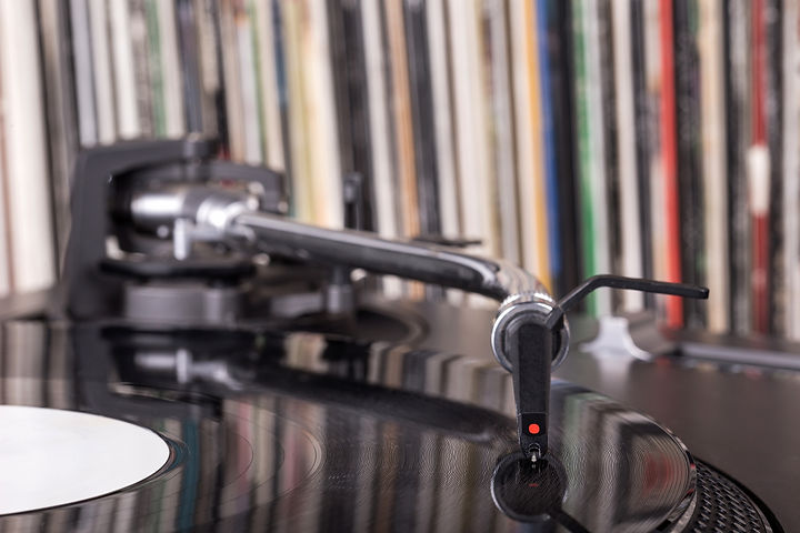 Dj Stylus On Spinning Vinyl, Record Background.jpg